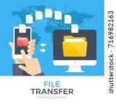 file transfer. hand holding... | Shutterstock .eps vector #716982163