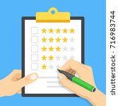 clipboard with star rating.... | Shutterstock .eps vector #716983744