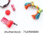 Stock photo red grooming equipment for care and training pet on white background top view mock up 716984884