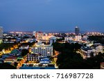 building and city lights at... | Shutterstock . vector #716987728