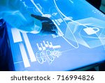 hands touching on a cyber space ... | Shutterstock . vector #716994826