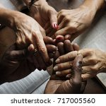 group of people holding hands... | Shutterstock . vector #717005560