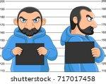 arrested man posing for mugshot ... | Shutterstock .eps vector #717017458