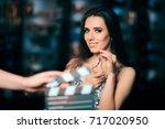 model acting in perfume... | Shutterstock . vector #717020950