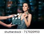 model acting in perfume... | Shutterstock . vector #717020953