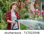 Happy young woman gardener...