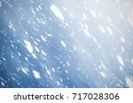snowflakes rays and bokeh or... | Shutterstock . vector #717028306