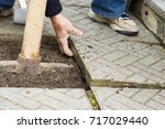 repair of the tile pavement.... | Shutterstock . vector #717029440