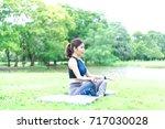 women lifestyle healthy yoga in ... | Shutterstock . vector #717030028