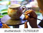 woman working in her pottery... | Shutterstock . vector #717031819