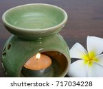 a green ceramic aromatherapy... | Shutterstock . vector #717034228