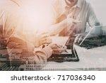 businessmen working together on ... | Shutterstock . vector #717036340