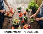 married couple cooking together ...   Shutterstock . vector #717038986