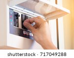 the electrician on hand open... | Shutterstock . vector #717049288