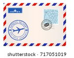envelope with stamps and... | Shutterstock .eps vector #717051019