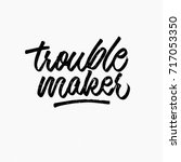 trouble maker. ink hand...   Shutterstock .eps vector #717053350