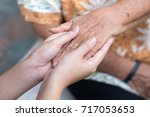 old and young holding hands ...   Shutterstock . vector #717053653