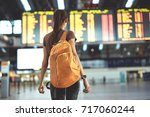 young woman with small backpack ... | Shutterstock . vector #717060244
