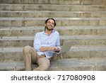 young attractive latin man... | Shutterstock . vector #717080908