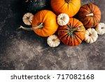 pumpkins on a black background. ...   Shutterstock . vector #717082168