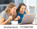 two excited friends finding on... | Shutterstock . vector #717084784
