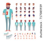 brutal bearded guy with tattoo... | Shutterstock .eps vector #717085939