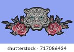 Stock vector embroidery oriental patch with tiger head and roses vector embroidered floral sticker with flowers 717086434