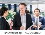 group of business partners... | Shutterstock . vector #717096880