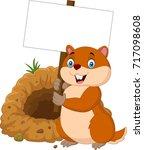 cartoon groundhog holding blank ... | Shutterstock .eps vector #717098608