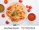 delicious penne pasta on wood... | Shutterstock . vector #717101314