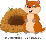 cartoon groundhog in front of... | Shutterstock .eps vector #717103390