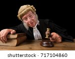 mature judge with authentic... | Shutterstock . vector #717104860
