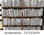 a cupboard full of paper files  ... | Shutterstock . vector #717112474