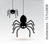 cartoon spiders with cobwebs in ... | Shutterstock .eps vector #717112858