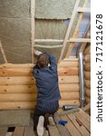 worker installing insulation... | Shutterstock . vector #717121678