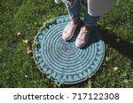 woman's legs on manhole. top... | Shutterstock . vector #717122308