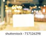 blank white retail store sign... | Shutterstock . vector #717126298