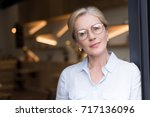 head and shoulders shot of... | Shutterstock . vector #717136096