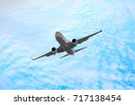 passenger airplane in the... | Shutterstock . vector #717138454