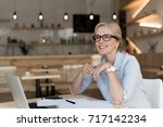 smiling mature businesswoman in ... | Shutterstock . vector #717142234