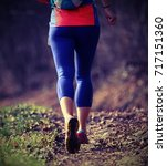 legs of an isolated runner... | Shutterstock . vector #717151360