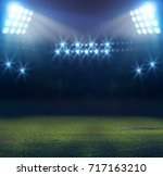 stadium in lights and flashes... | Shutterstock . vector #717163210