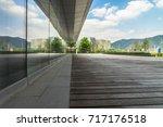 empty wooden footpath front... | Shutterstock . vector #717176518