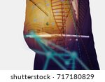 double exposure image of... | Shutterstock . vector #717180829