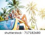 four female friends sitting on... | Shutterstock . vector #717182680