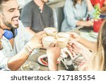 happy friends toasting... | Shutterstock . vector #717185554