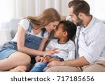 happy couple with adopted... | Shutterstock . vector #717185656