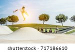 young skater jumping with... | Shutterstock . vector #717186610