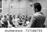 speaker giving a talk on... | Shutterstock . vector #717186733