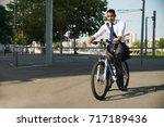 successful latin businessman... | Shutterstock . vector #717189436